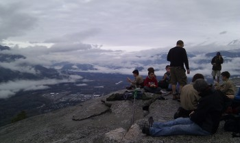 A little rest and some lunch before we do the investiture ceremony high above Howe Sound and the town of Squamish. Don't drop your apples boys; they'll roll off the edge and could hit climbers on the rock face below.