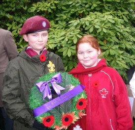 Scout Simon and his sister, Samantha, lay a wreath on behalf of their elementary school.