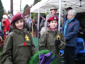 Scouts Isaac and Tavish lay a wreath on behalf of West Vancouver Scouting.