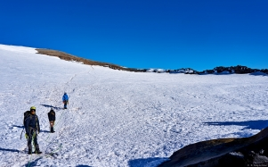 Crossing the crater on the way to the summit (upper left). There was no way to ignore the fact that you were standing in the mouth of the most dangerous stratovolcano in North America when you saw the vents scattered around the perimeter steaming out hot gases.