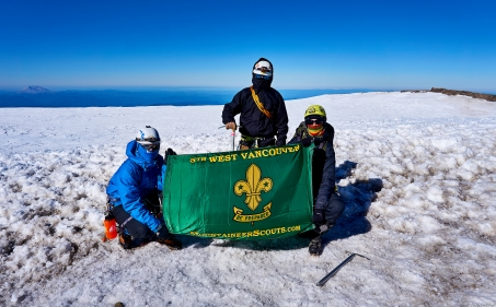This flag has sure travelled...it's been to the summit of Mt. Kilimanjaro in Tanzania (2013) and Youngs Peak in Rogers Pass (every summer since 2013). Perhaps we should have all the summits printed on it?