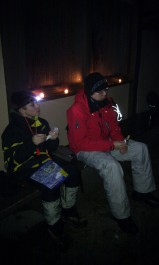 Wojtek & Scouter Jason check the map while they enjoy a snack in the Upper Warming Hut.