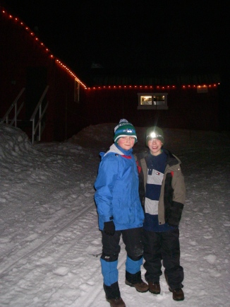 Simon and Finn enjoy the festive lights of the Hollyburn Lodge after hiking through the woods up to the Nordic Ski Area.