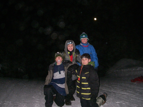 Finn, Isaac, Simon & Wojtek ham it up for the camera with the full moon over their shoulders after hiking to the Upper Warming Hut.