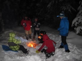 Relaxing around the campfire before bed. Thanks to Scouter Maciej for making such a nice campfire for the boys!