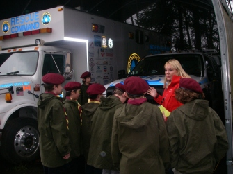 "The Scouts get up close with the team's fleet of specialized rescue vehicles nicknamed: ""Looking Glass"", ""Batt Mobile"", ""Mule Legger and ""Knuckles""."