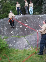 Scout Simon gets his first try at rappelling. This beginner size wall is perfect for teaching the scouts the basics before we move on to anything more challenging. Plus the view of Vancouver from this spot in Lighthouse Park is really amazing.