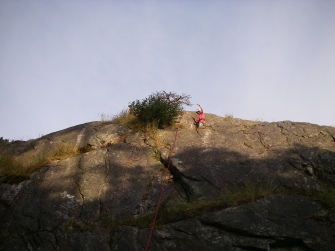 With the sun setting over our new home crag, Scout Tavish soaks in the applause from the Scout moms upon reaching the top for his first time!