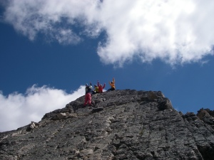 The team celebrates getting to the first (false) summit of Eastpost Spire. To get to the slightly higher true summit....well, we should have brought a guide book....turns out we needed to traverse the spire a little lower down and then resume climbing to the top...oh, well, gives us an excuse to go back one day. Careful guys...that's nearly a 1,000 foot drop down on both sides of that slab you're sitting on (1,600' straight down on the right to the Kain Hut).