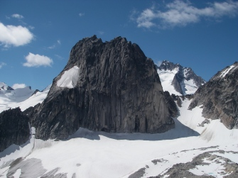 Friday: Welcome to the world famous climber's playground: the Bugaboos! Snowpatch Spiire in the middle with Pidgeon Spire in the background right and Bugaboo Spire coming into view on the hard right with the treacherous Snowpatch/Bugaboo col in the center-right (it's so steep that many rappel down rather than try to boot down - if you zoom in you can see the climbers' ascent route zig-zagging up the snow field). I really don't have a wide enough lens for this place...