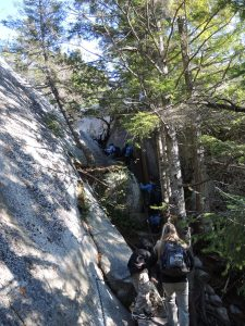 A little gap in the path to be jumped and then we begin to ascend the narrow, more vertical sections with chains.