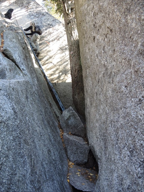 Ladders bolted into the walls help us get past the most difficult sections.