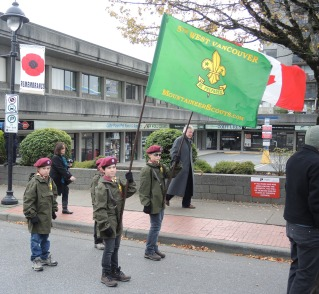 The Scouts are in position at the back of the parade and ready to go. It's a cold, damp day as most Remembrance Days seem to be but the Scouts will stay warm and dry with matching anoraks, wool berets and gloves.