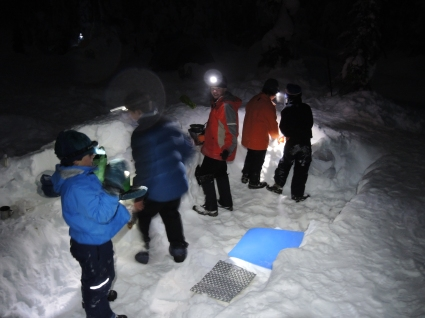 The Scouts begin preparing their Saturday night dinner. This was four of the Scouts' first time carving a kitchen and living area into the snow. I bet their next one will be even better.