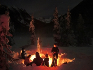 Saturday night campfire under a clear sky up in the mountains of Joffre Lake Provincial Park. The light on the lake just left of center is the headlamp of a member of a team of backcountry skiers coming down the mountain very late Saturday night. They were probably as surprised to see us there that night as we were to see them.