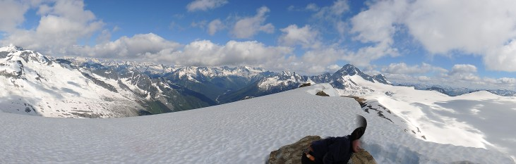 A summit panorama catches one Scout just as he is trying to duck out of frame.