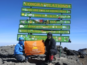 HERA Women's Cancer Foundation flag on the summit of Mt. Kilimanjaro.