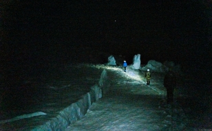 We are strangers in a strange land. Climbing in the freezing darkness up the great mountain past gaping crevasses and strange ice formations created by the moving glacier - lit only by our headlamps. Higher and higher we climb. The hours passing by as the night wears on...